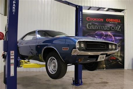 Picture of a car and rolling door at Graveyard Carz