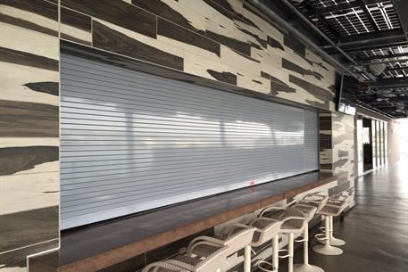 Close up side view of a counter shutter utilized in a restaurant
