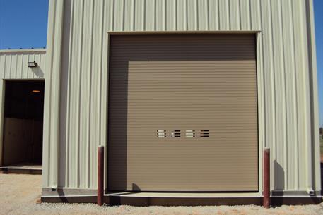 Rolling steel door on building -  Overhead Insulated Door Thermiser Max