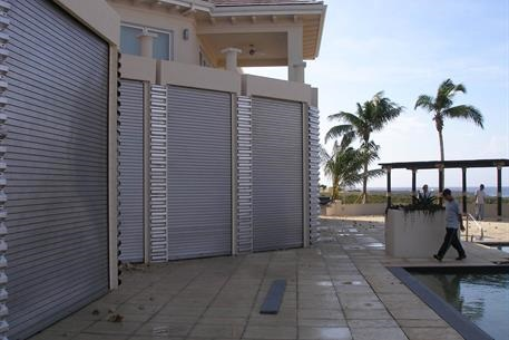Residential property showing multiple rolling doors closed